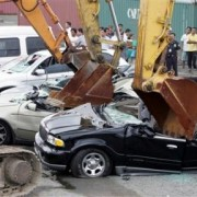 1105325611-backhoes-used-destroy-smuggled-luxury-cars-suvs-lincoln-navigators-bmw
